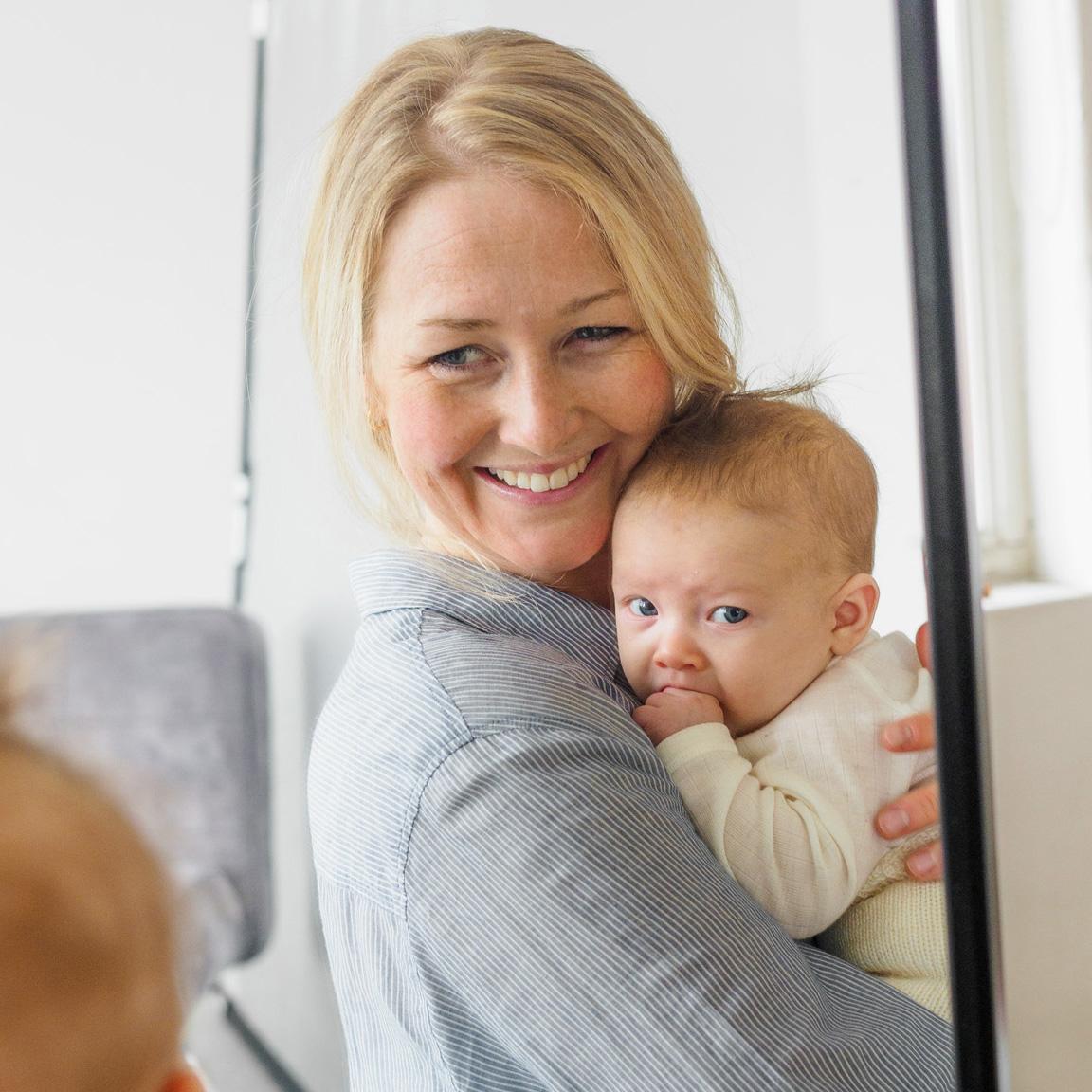 Kvinne med spedbarn