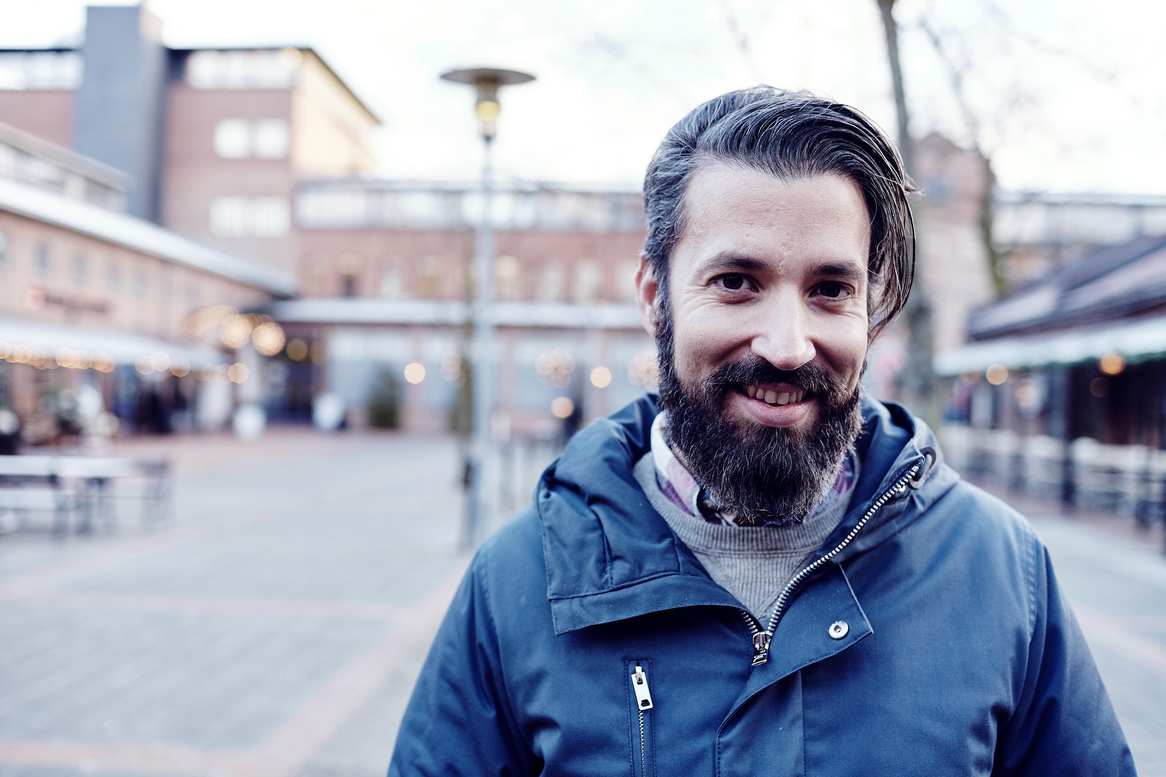 Smiling man at a square