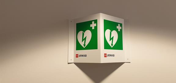 Se etter lignende symboler for å finne en hjertestarter.