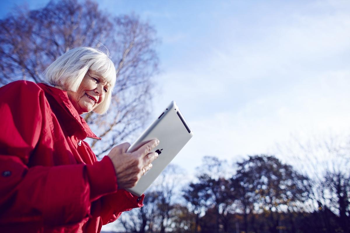 A woman looking at an iPad