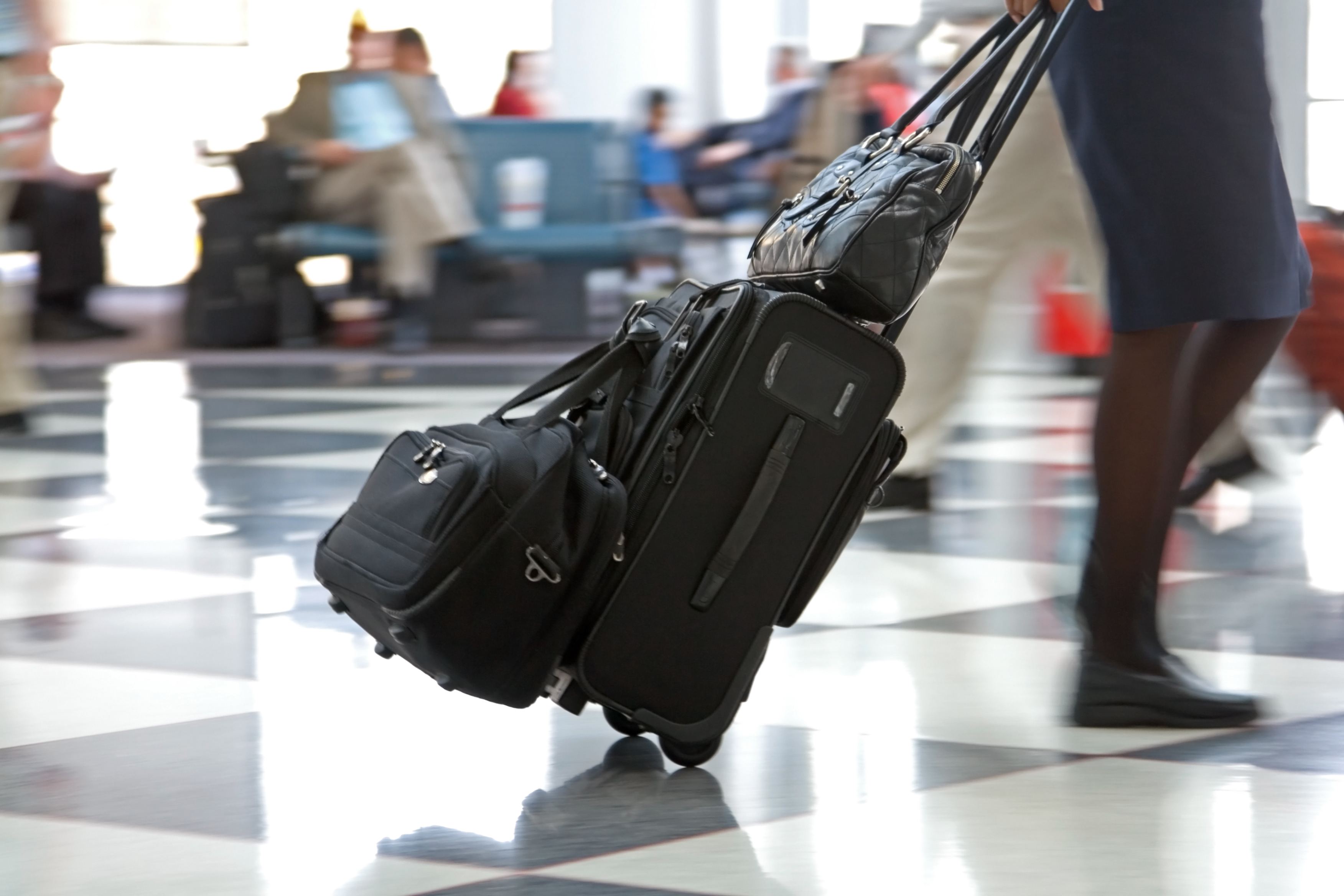Rolling suitcase on airport floor