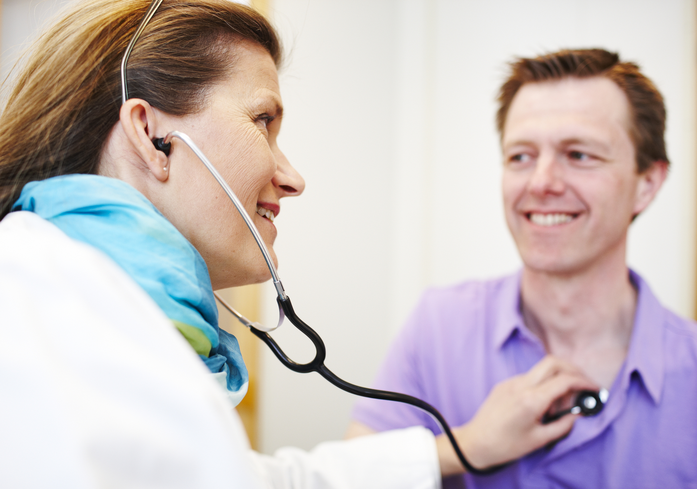 Man getting checked by a doctor
