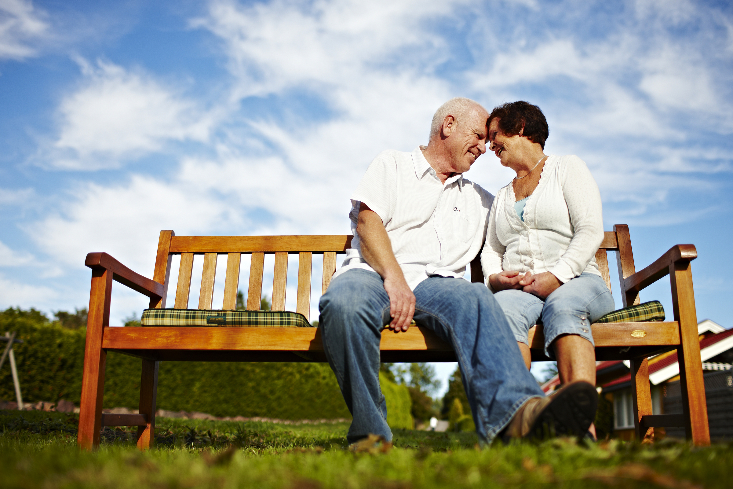 Happy old couple on a bench